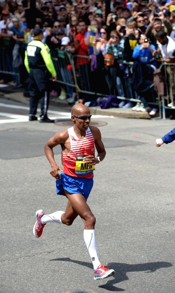 Meb Keflezighi of the U.S. runs to the finishing line during 2014 Boston marathon, in Boston, Massachusetts, the United States, April 21, 2014. Meb Keflezighi ...