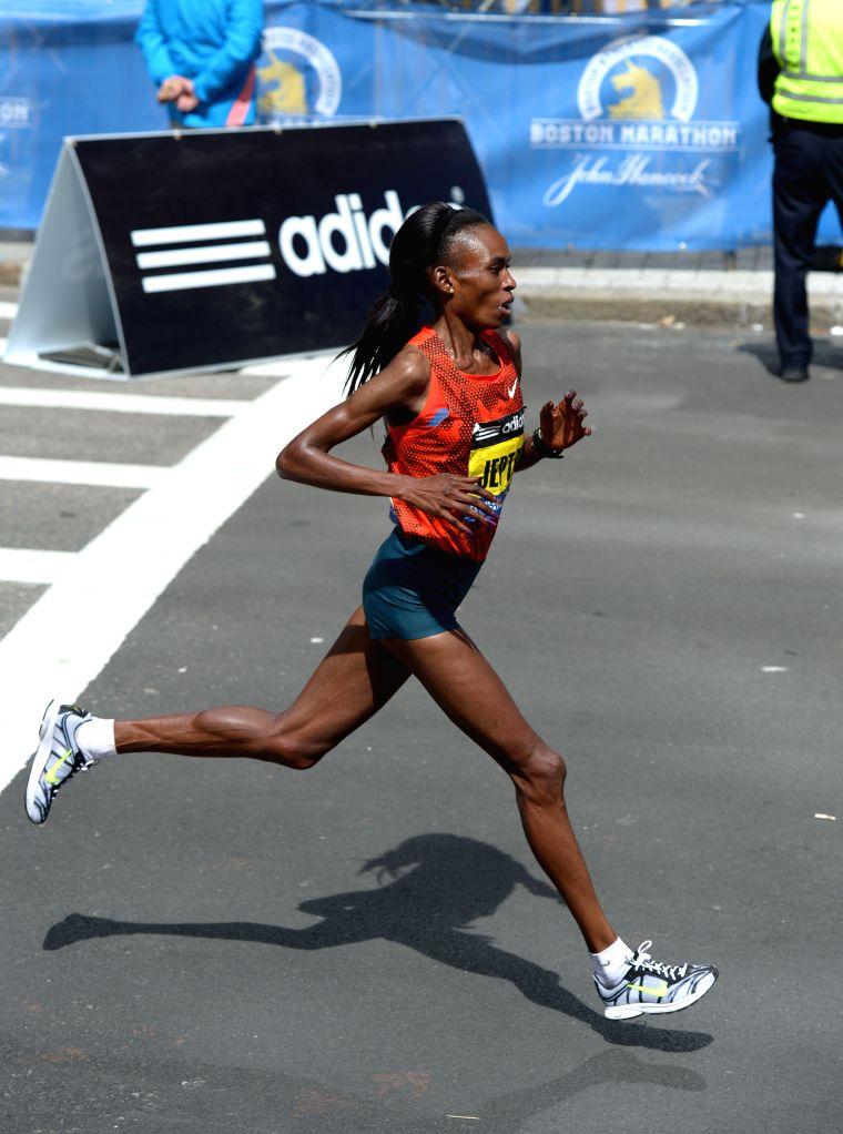 Rita Jeptoo of Kenya runs to the finishing line during 2014 Boston marathon in Boston, Massachusetts, the United States, April 21, 2014. Rita Jeptoo claimed the ...
