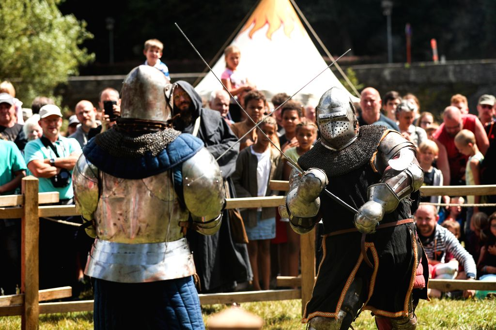 BOUILLON (BELGIUM), Aug. 10, 2019 Heavily armoured fighters perform combat during the annual medieval festival in the city of Bouillon in south Belgium, Aug. 10, 2019. The annual medieval ...