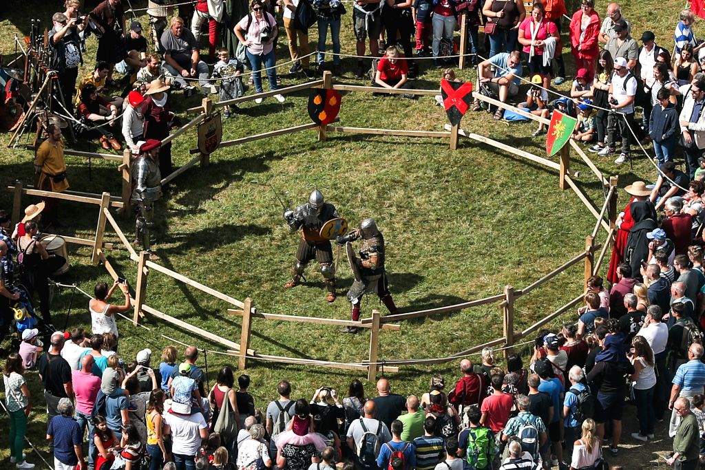 BOUILLON (BELGIUM), Aug. 10, 2019 Spectators watch a combat performance during the annual medieval festival in the city of Bouillon in south Belgium, Aug. 10, 2019. The annual medieval ...