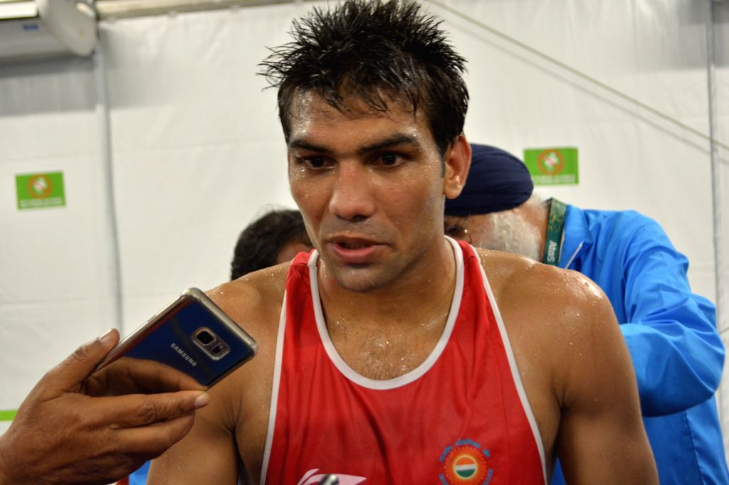 Boxer Manoj Kumar talking to reporters after beating Evaldas Petrauskas of Lithuania in the men\'s Light Welterweight (64kg) category at the Riocentrio Pavilion at Rio Olympics. - Manoj Kumar
