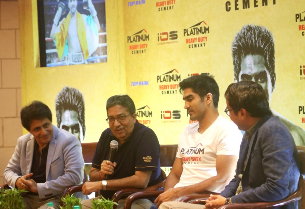 Boxer Vijender Singh accompanied by officials of Platinum Heavy Duty Cement during a press conference in New Delhi, on July 18, 2019. - Vijender Singh