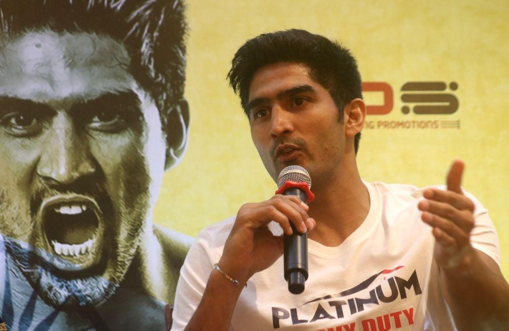 Boxer Vijender Singh addresses a press conference in New Delhi, on July 18, 2019. - Vijender Singh