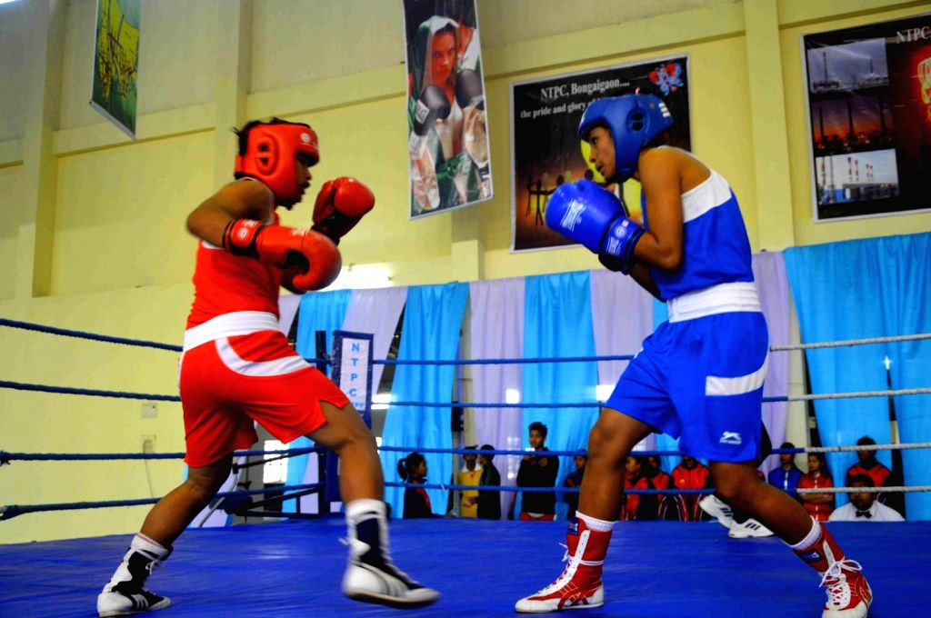 Boxers in action during 1st NTPC `The Punch` Knockout Challenge Inter BTAD School Girls Boxing Championship at SAI, Special Area Games Complex (SAGC) in Kokrajhar on Dec.20, 2013.