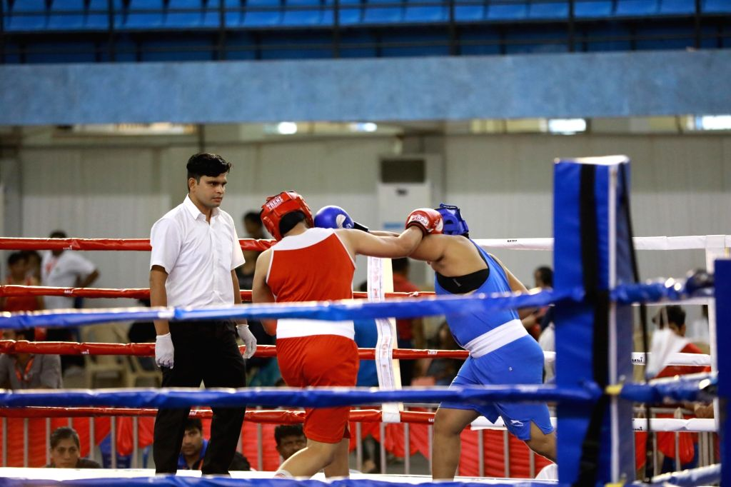Boxers in action during the 4th Elite Women's National Boxing Championships at the Mundayad Indoor Stadium in Kannur, Kerala on Dec 5, 2019.