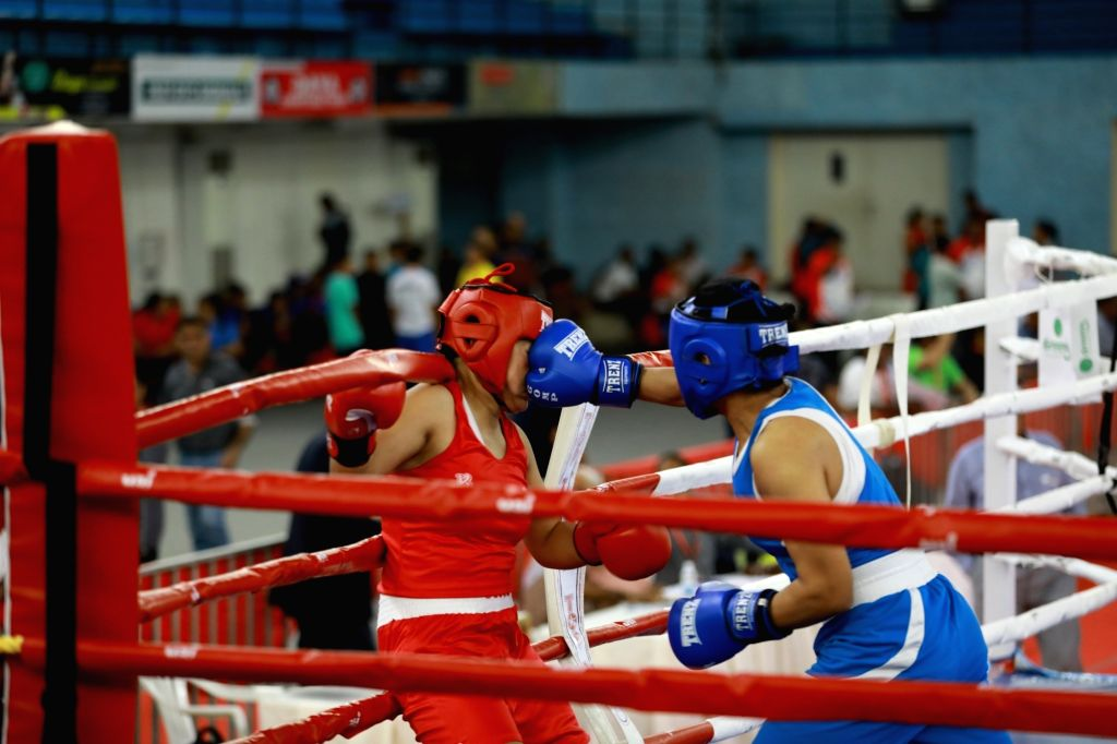 Boxers in action on the second day of 4th Elite Women's National Boxing Championships at the Mundayad Indoor Stadium in Kannur, Kerala on Dec 4, 2019.