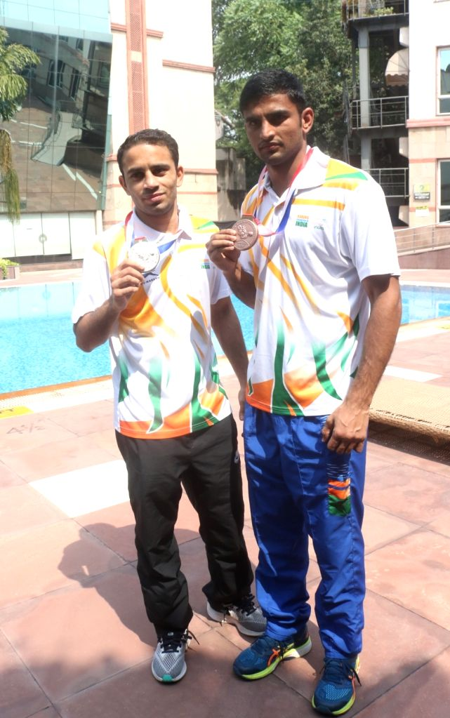 Boxers Manish Kaushik and Amit Panghal, who clinched a Bronze and a Silver each at the Men's World Boxing Championships, during an interactive session, in New Delhi on Sep 23, 2019.