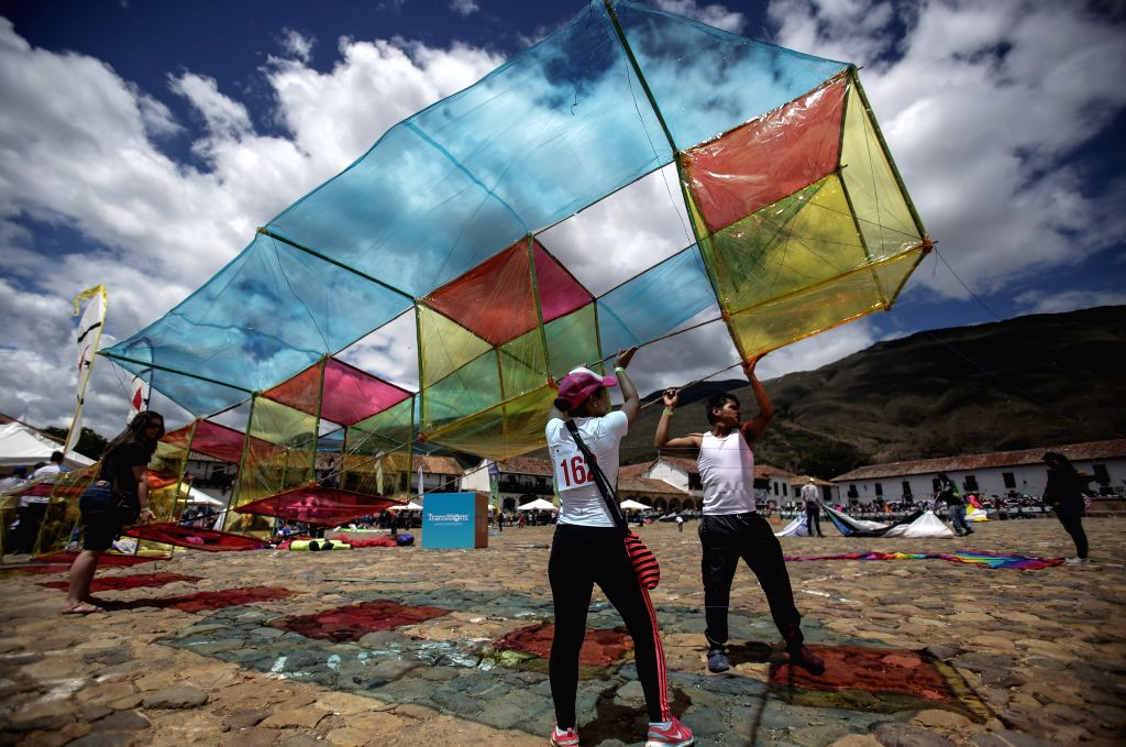BOYACA, Aug. 21, 2017 - People prepare to fly a kite during the Wind and Kites Festival in Villa de Leyva, in Boyaca, Colombia, on Aug. 20, 2017.