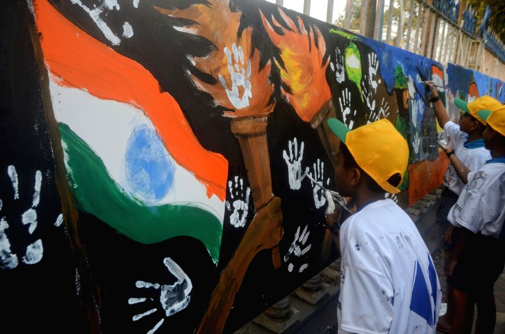 Boys participate in a painting programme to pay tributes to 49 CRPF men killed in Jammu and Kashmir's Pulwama district militant attack on 14th Feb 2019; in Kolkata, on Feb 17, 2019.