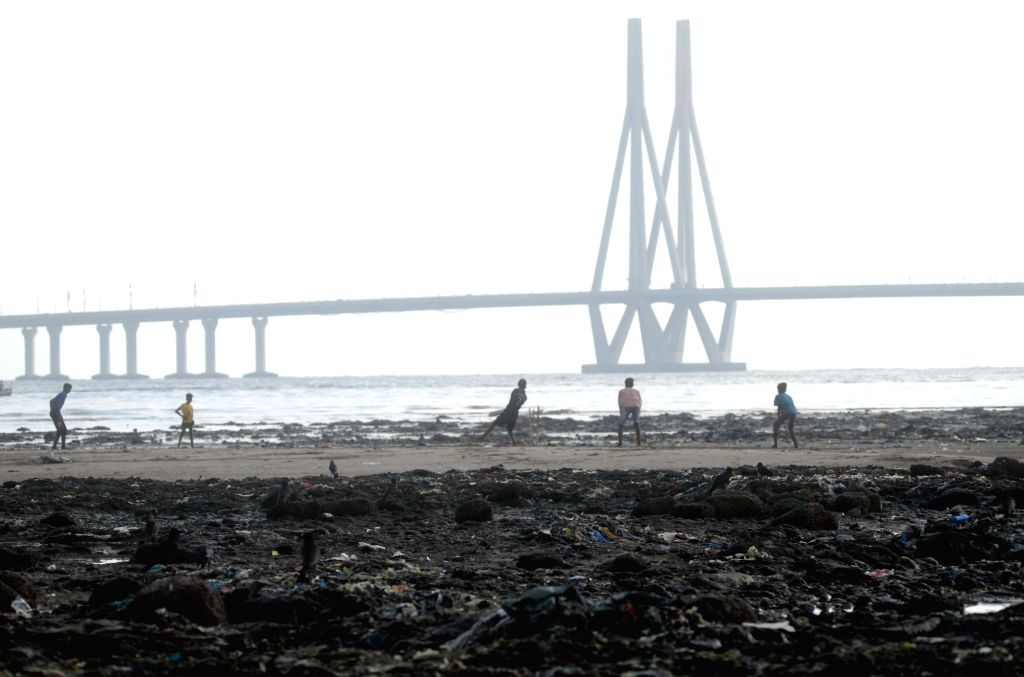 Boys seen playing cricket on the banks of the Mithi river near Mahim in Mumbai, on June 3, 2019.
