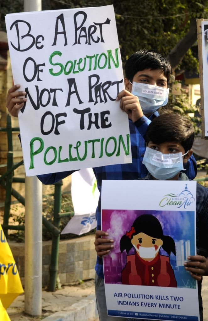 Boys wearing pollution masks participate in an awareness campaign against air pollution in Kolkata, on Jan 27, 2019.