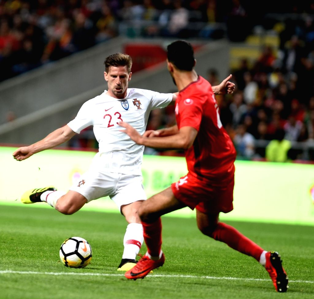 BRAGA, May 29, 2018 - Adrien Silva (L) of Portugal shoots during the 2018 World Cup friendly soccer match between Portugal and Tunisia at Braga Municipal Stadium in Braga, Portugal, on May 28, 2018. ...