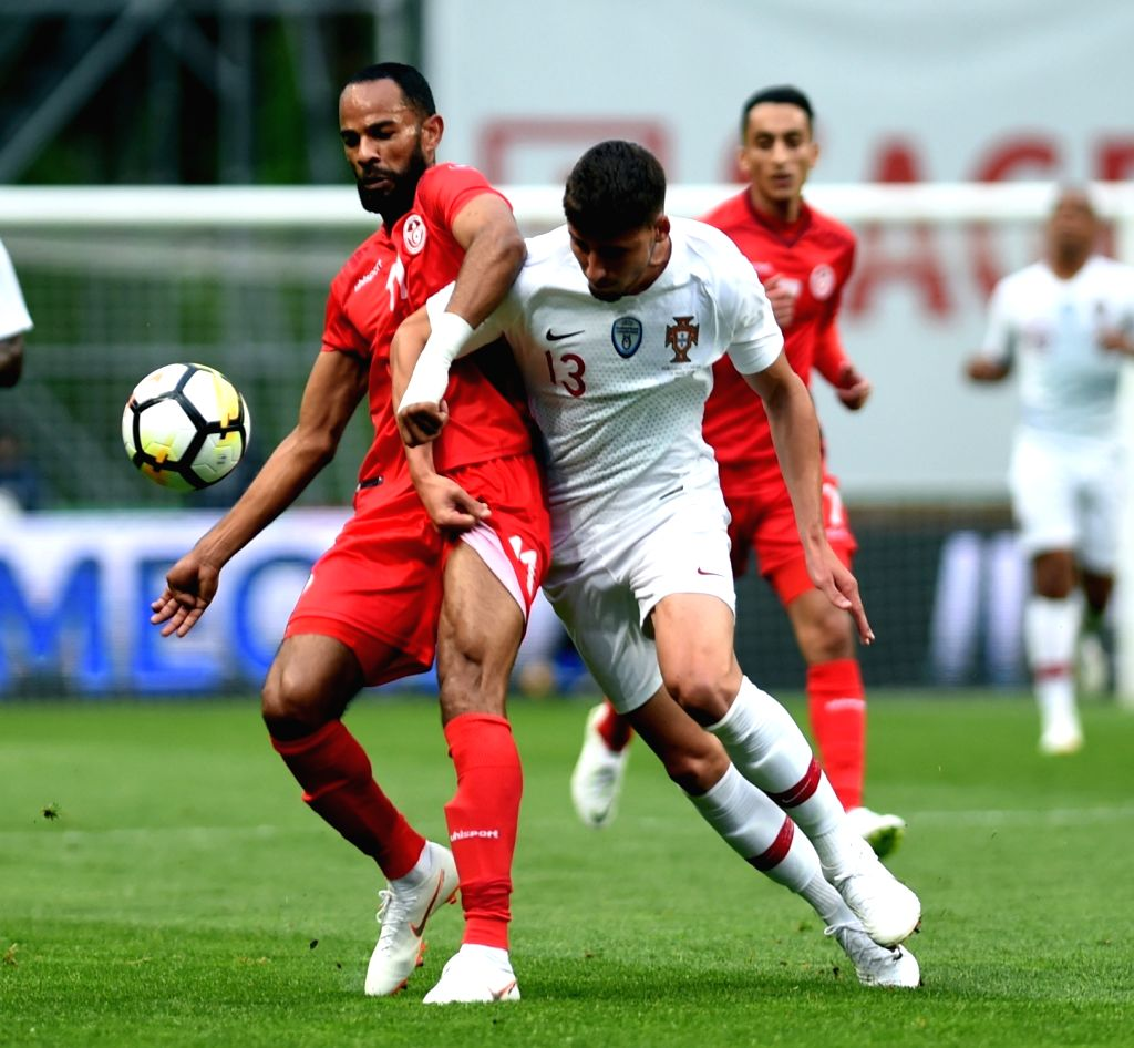 BRAGA, May 29, 2018 - Ruben Dias (R) of Portugal vies with Saber Khalifa of Tunisia during the 2018 World Cup friendly soccer match between Portugal and Tunisia at Braga Municipal Stadium in Braga, ...