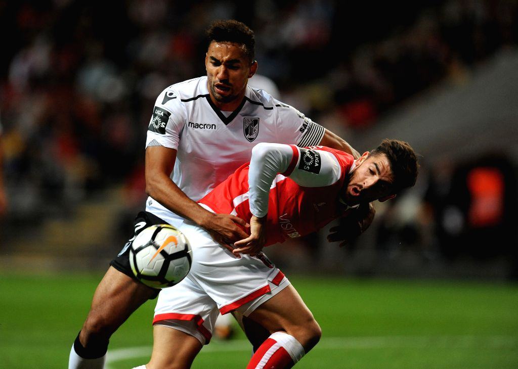 BRAGA, Sept. 18, 2017 - Braga's Paulinho (R) vies with Viotria Guimaraes' Pedro Henrique during the 2017/2018 Portuguese League soccer match at Braga Municipal Stadium in Braga, Portugal, Sept. 17, ...