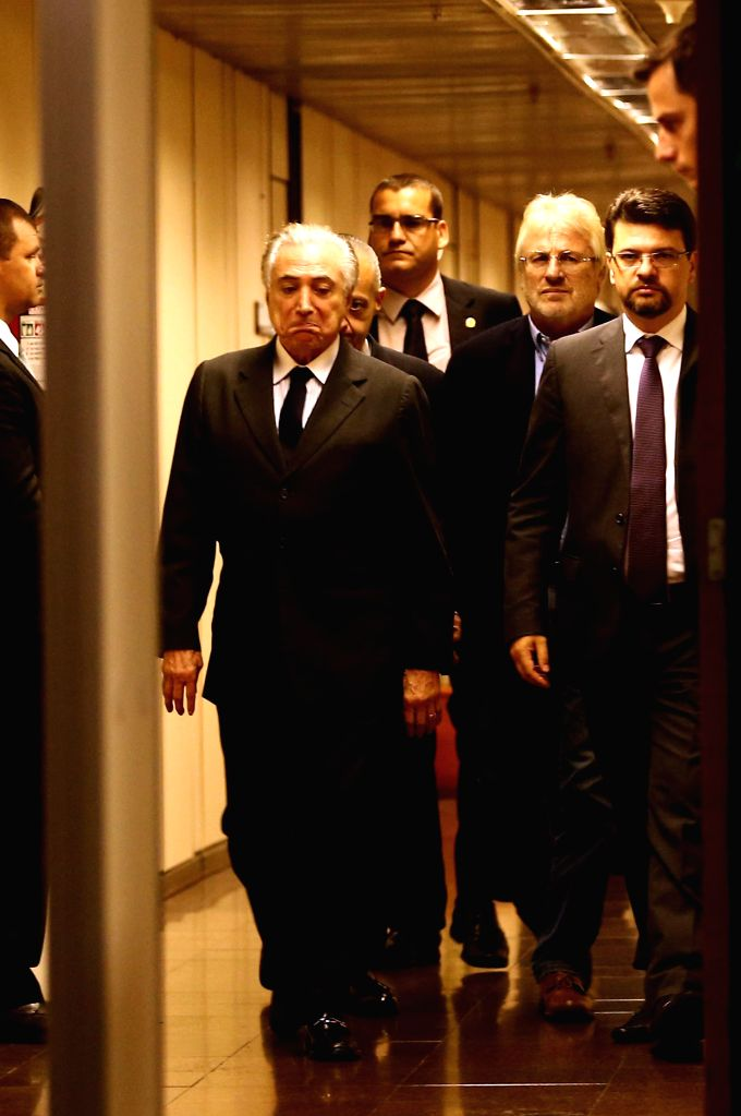 BRASILIA, April 11, 2016 - Brazilian Vice President Michel Temer (L, front) walks in the building attached to the Plenalto Palace in Brasilia, Brazil, on April 11, 2016. An audio recording with the ...