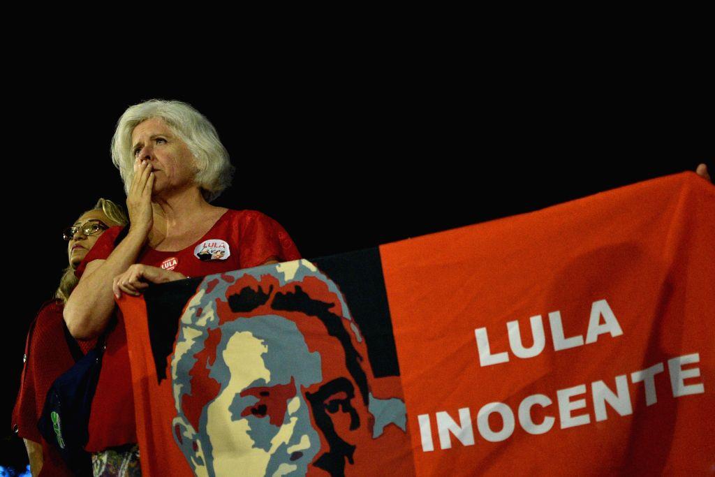 BRASILIA, April 5, 2018 - Supporters of former Brazilian President Luiz Inacio Lula da Silva react during a demonstration in support of Lula, in Brasilia, Brazil, on April 4, 2018. Brazil's Supreme ...