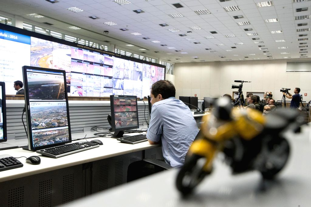 BRASILIA, Dec. 10, 2013 (Xinhua/IANS) -- A staff member watches the video surveillance at the Extraordinary Secretariat of Security for Major Events (SESGE) in Brasilia, capital of Brazil, Dec. 9, 2013. In order to coordinate the public security and