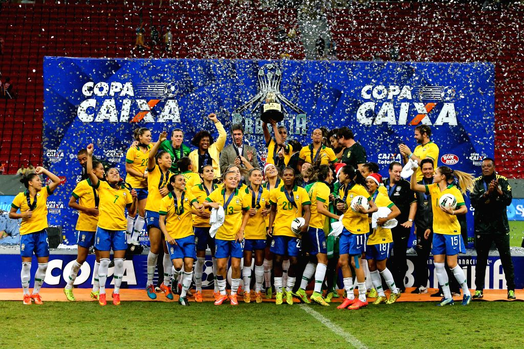 Brazil's players celebrate during the awarding ceremony after the match between Brazil and the United States of the 2014 International Women's Football Tournament .