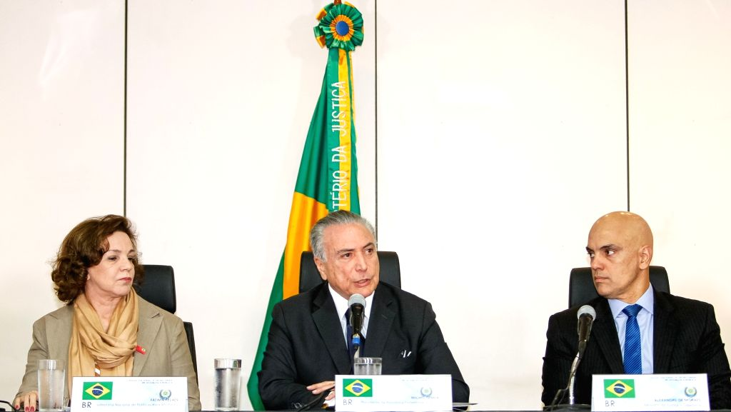 BRASILIA, June 1, 2016 - Image provided by Brazil's Presidency shows interim President Michel Temer (C) speaking, while National Secretary of Policy for Women Fatima Pelaes Fatima Pelaes (L) and ... - Alexandre