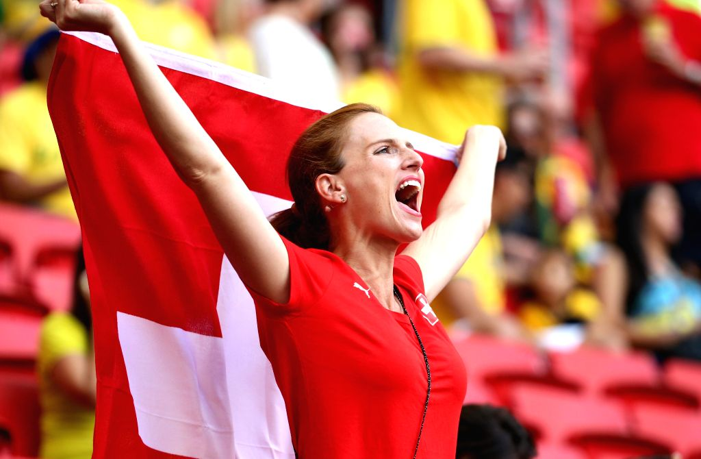 A Switzerland's fan cheers for her team before a Group E match between Switzerland and Ecuador of 2014 FIFA World Cup at the Estadio Nacional Stadium in Brasilia, .