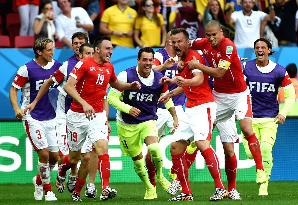 Switzerland's Haris Seferovic (2nd R, front) who scores Switzerland's second goal celebrates with his teammates for the victory after a Group E match between ...