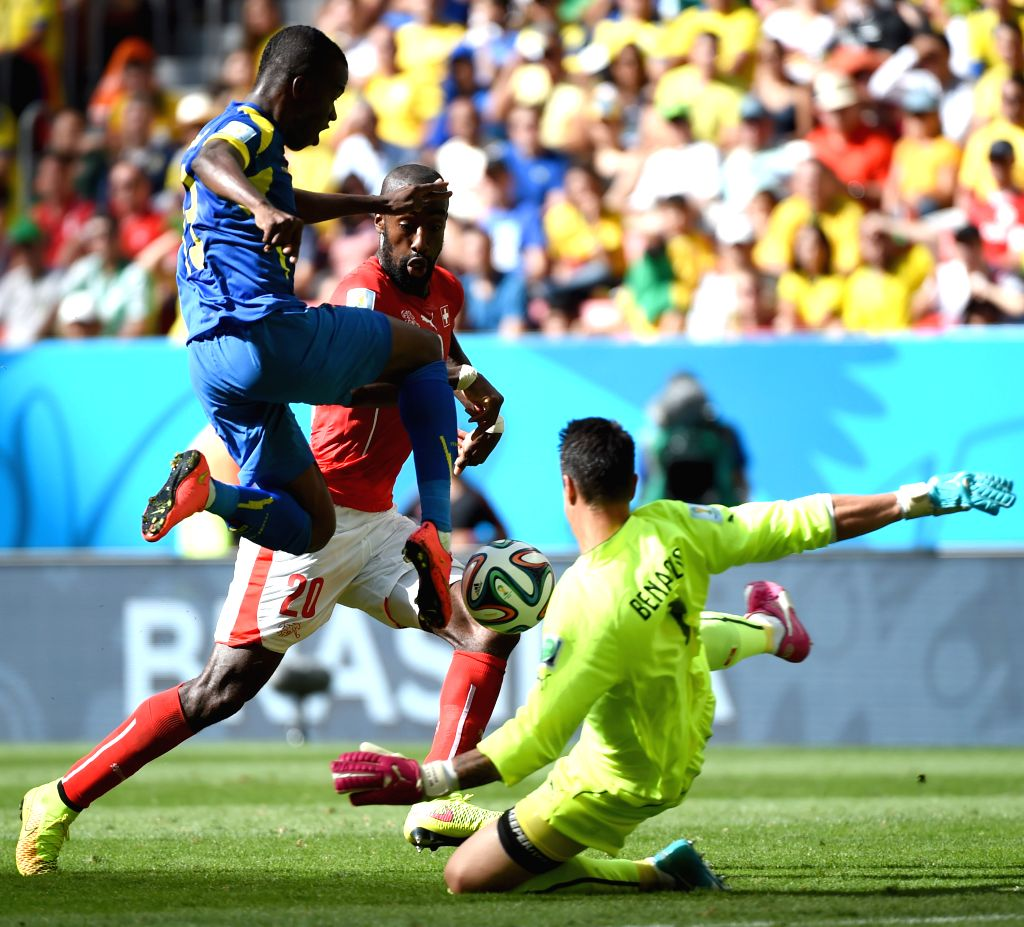 Switzerland's Johan Djourou (C) and goalkeeper Diego Benaglio (R) tries to stop the ball controlled by Ecuador's Enner Valencia (L) during a Group E match between .