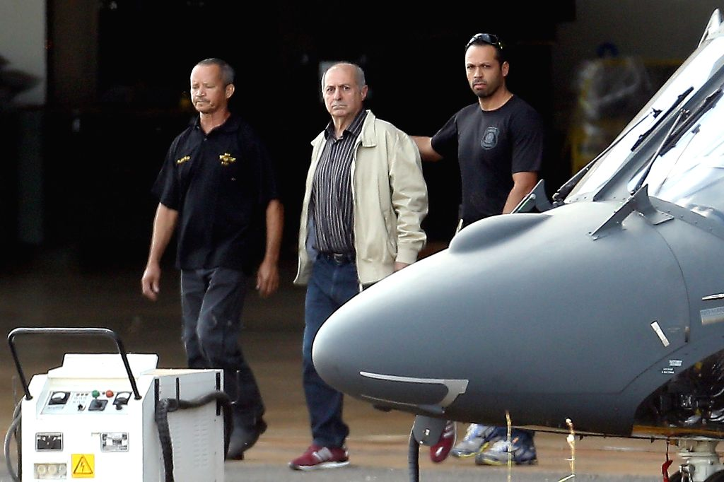 BRASILIA, June 24, 2016 - Paulo Bernardo Silva (C) is guarded by officers to the plane of the Federal Police after being arrested in Brasilia, Brazil, on June 23, 2016. Paulo Bernardo Silva, a former ...