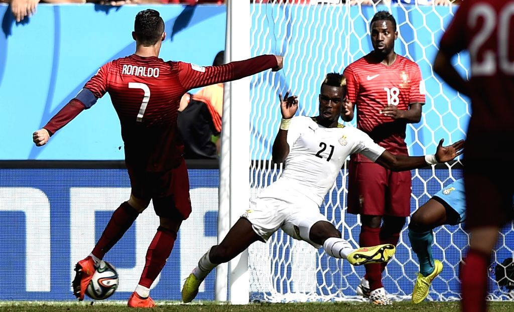 Portugal's Cristiano Ronaldo (1st L) shoots a goal during a Group G match between Portugal and Ghana of 2014 FIFA World Cup at the Estadio Nacional Stadium in ...