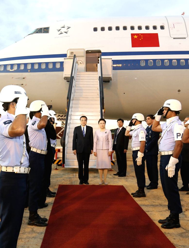 Chinese Premier Li Keqiang and his wife Cheng Hong arrive in Brasilia on May 18, 2015 for an official visit to Brazil at the invitation of Brazilian President Dilma ...
