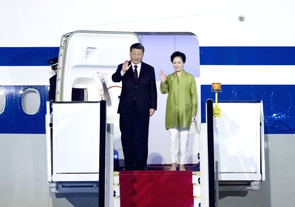 BRASILIA, Nov. 12, 2019 - Chinese President Xi Jinping and his wife Peng Liyuan walk out of the plane upon their arrival in Brasilia, Brazil, Nov. 12, 2019. Chinese President Xi Jinping arrived here ...