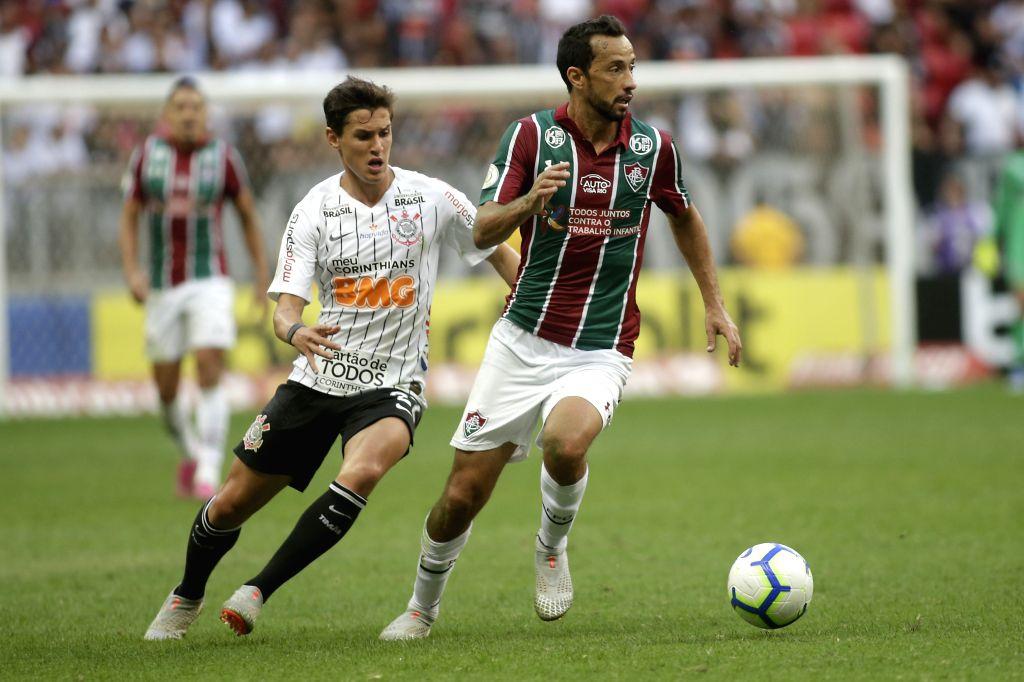 BRASILIA, Sept. 16, 2019 - Mateus Vital (L) of Corinthian vies with Nenen of Fluminense during their Brazilian Soccer Championship held at the National Stadium in Brasilia, Brazil, on Sept. 15, 2019.