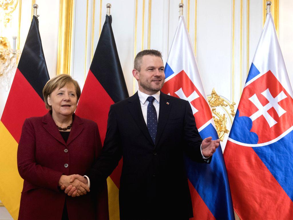 BRATISLAVA, Feb. 7, 2019 - Slovak Prime Minister Peter Pellegrini (R) meets with German Chancellor Angela Merkel in Bratislava, Slovak, Feb. 7, 2019. Slovak Prime Minister Peter Pellegrini has ... - Peter Pellegrini
