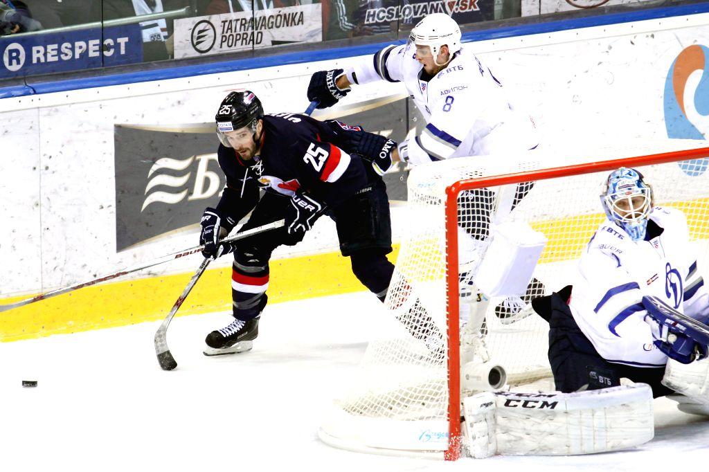 Marek Viedensky (1st L) of HC Slovan Bratislava vies with Denis Barantsev of Dynamo Moscow during a Kontinental Hockey League (KHL) match in Bratislava, Slovakia, ...