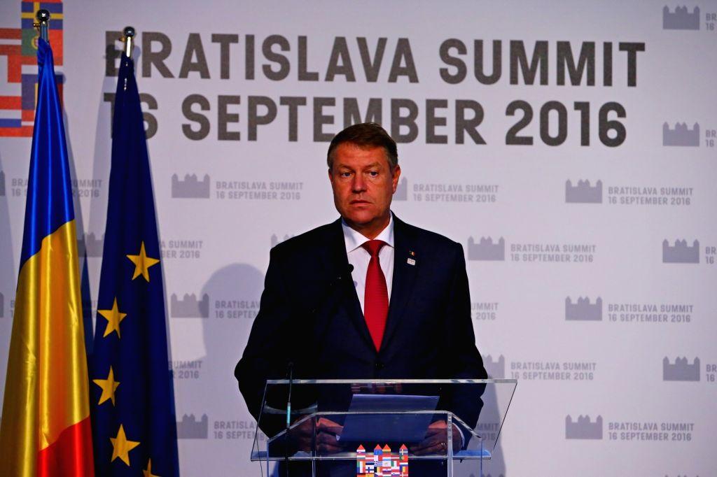 BRATISLAVA, Sept. 17, 2016 - Romanian President Klaus Iohannis attends a press conference after an informal European Union (EU) summit in Bratislava, Slovakia, Sept. 16, 2016. EU members on Friday ... - Robert Fico