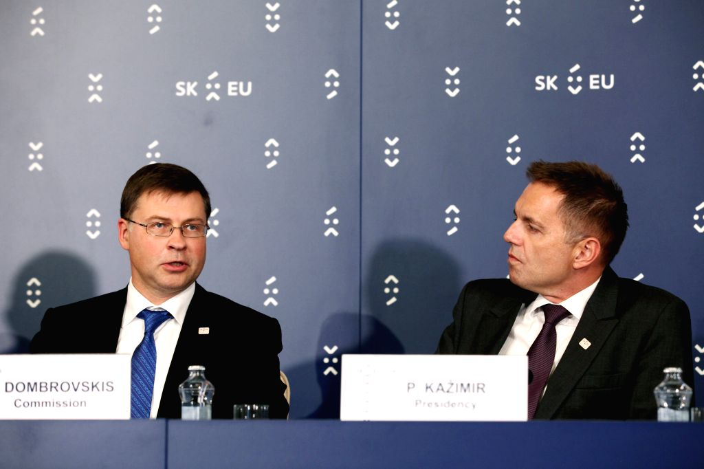BRATISLAVA, Sept. 9, 2016 - European Commissioner for the Euro and Social Dialogue Valdis Dombrovskis(L) speaks at a press conference in Bratislava, Slovakia on Sept. 9, 2016. The European Union (EU) ...