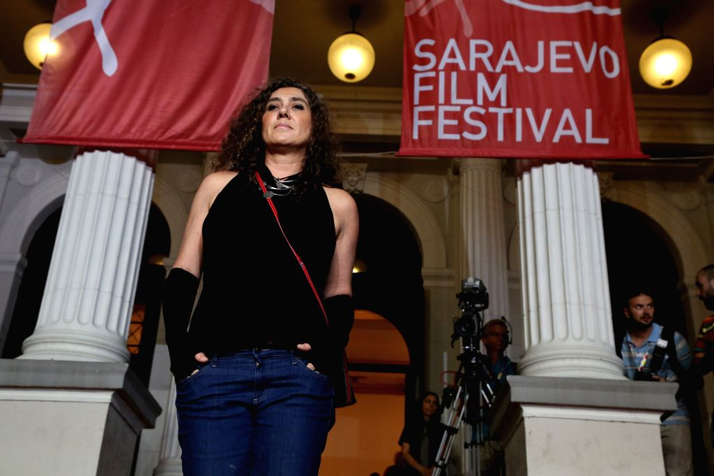 Brazilian film director Anne Muylaert poses for photos in front of the National Theater in Sarajevo, Bosnia-Herzegovina, Aug. 14, 2015. The 21st Sarajevo Film ...