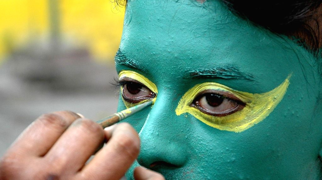 Brazilian football fans of Kolkata painting their face to cheer up for team in Kolkata on June 28, 2014.