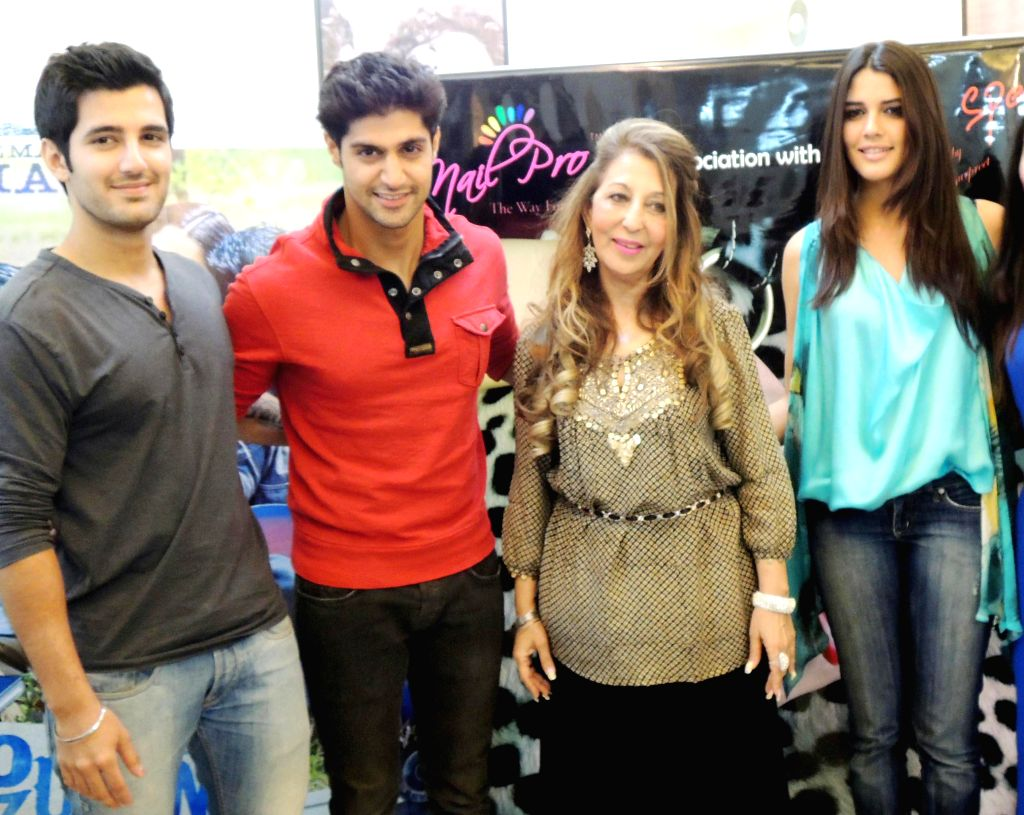 Brazilian model and actress Izabelle with Tanuj Virwani and Aditya Seal during an event to promote their upcoming film 'Purani Jeans' in Gurgaon on April 20, 2014. - Izabelle