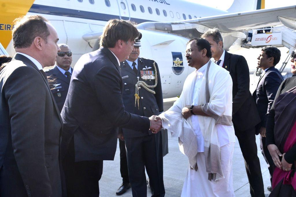 Brazilian President Jair Bolsonaro being received by MoS External Affairs Minister V. Muraleedharan on his arrival in New Delhi on Jan 25, 2020. The President, who is the Chief Guest in ... - V. Muraleedharan