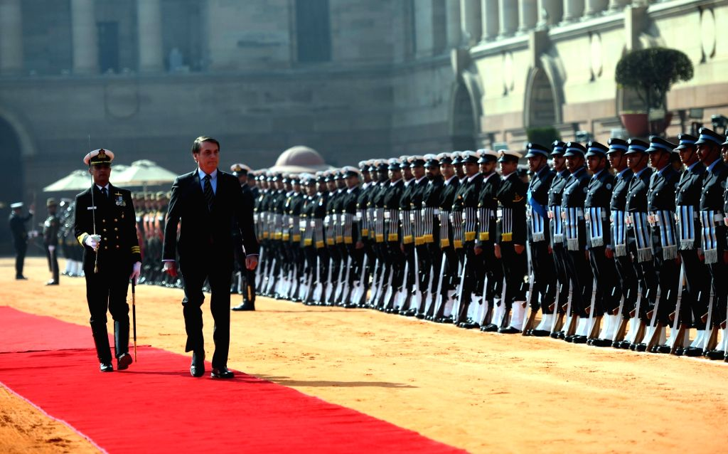 Brazilian President Jair Bolsonaro inspects the Guard of Honour at a Ceremonial Reception accorded to him at Rashtrapati Bhavan in New Delhi on Jan 25, 2020.