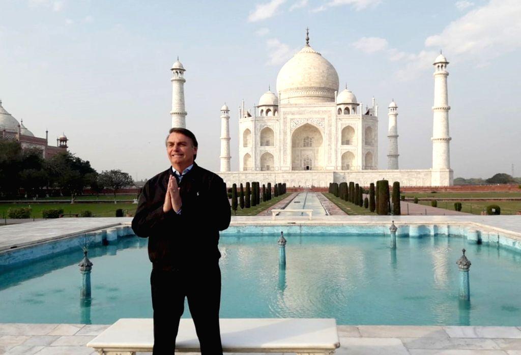 Brazilian President Jair Messias Bolsonaro poses in front of the Taj Mahal during his visit to Agra on Jan 27, 2020.