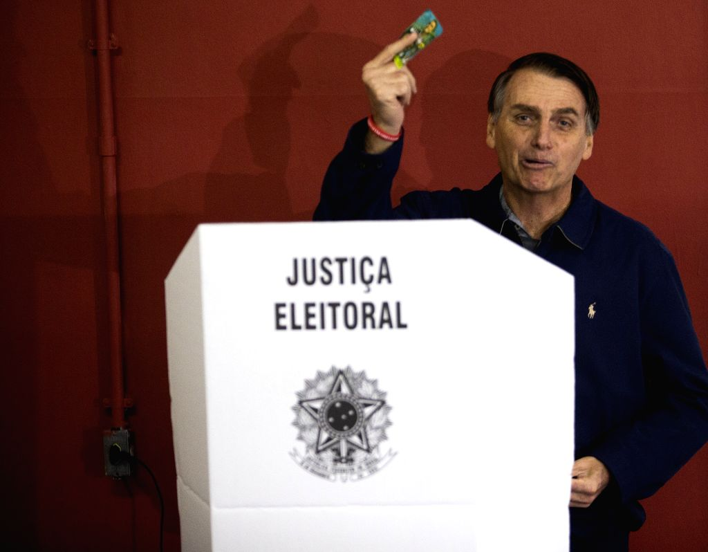 : Brazilian presidential candidate of the Social Liberal Party Jair Bolsonaro casts his vote during the general elections, in Marechal Hermes, in the north ...