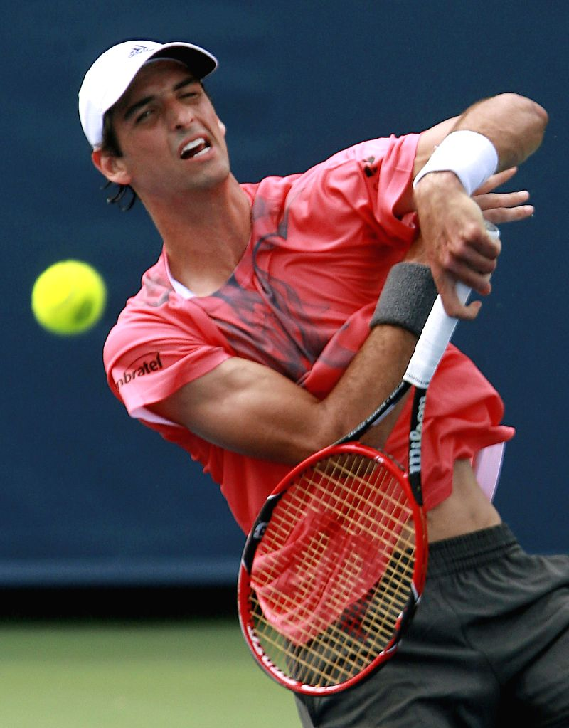 Brazilian tennis player Thomaz Bellucci serves to Czech Jiri Vesely during their Cincinnati tournament first round match at the Lindner Tennis Center of Mason, Ohio (United States), 17 August 2015. ...