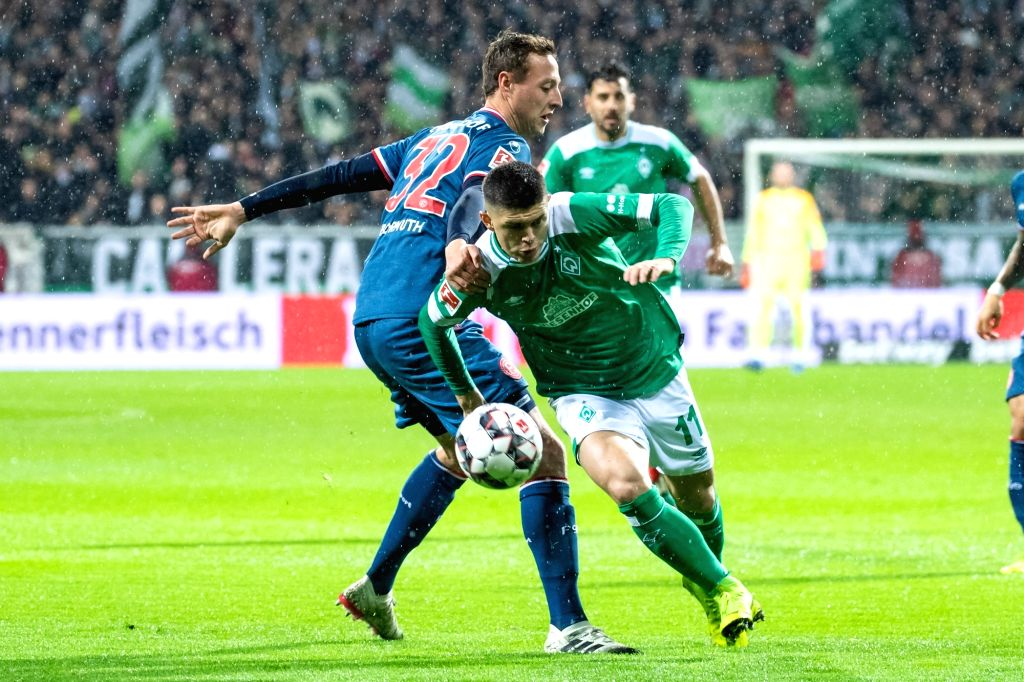 BREMEN, Dec. 8, 2018 - Bremen's Milot Rashica (R) vies with Duesseldorf's Robin Bormuth during a German Bundesliga match between SV Werder Bremen and Fortuna Duesseldorf, in Bremen, Germany, on Dec. ...