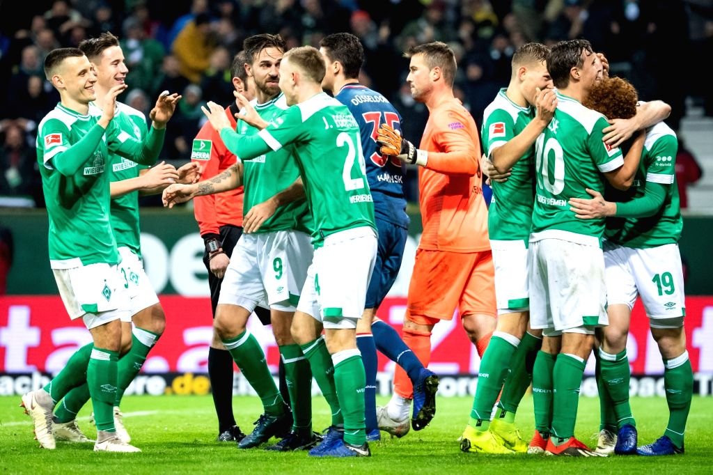 BREMEN, Dec. 8, 2018 - Bremen's players celebrate scoring during a German Bundesliga match between SV Werder Bremen and Fortuna Duesseldorf, in Bremen, Germany, on Dec. 8, 2018. Duesseldorf lost 1-3.