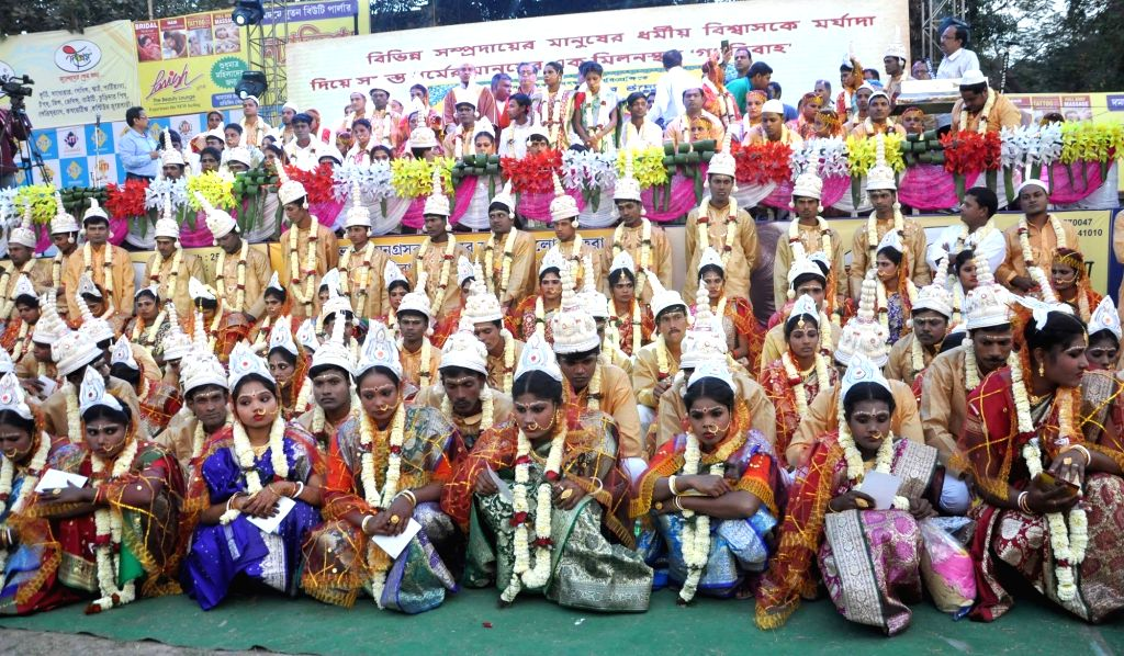 Brides and bridegrooms during a mass marriage programme where couples following Hinduism, Islam and Christianity got married in Kolkata, on Feb 14, 2018.