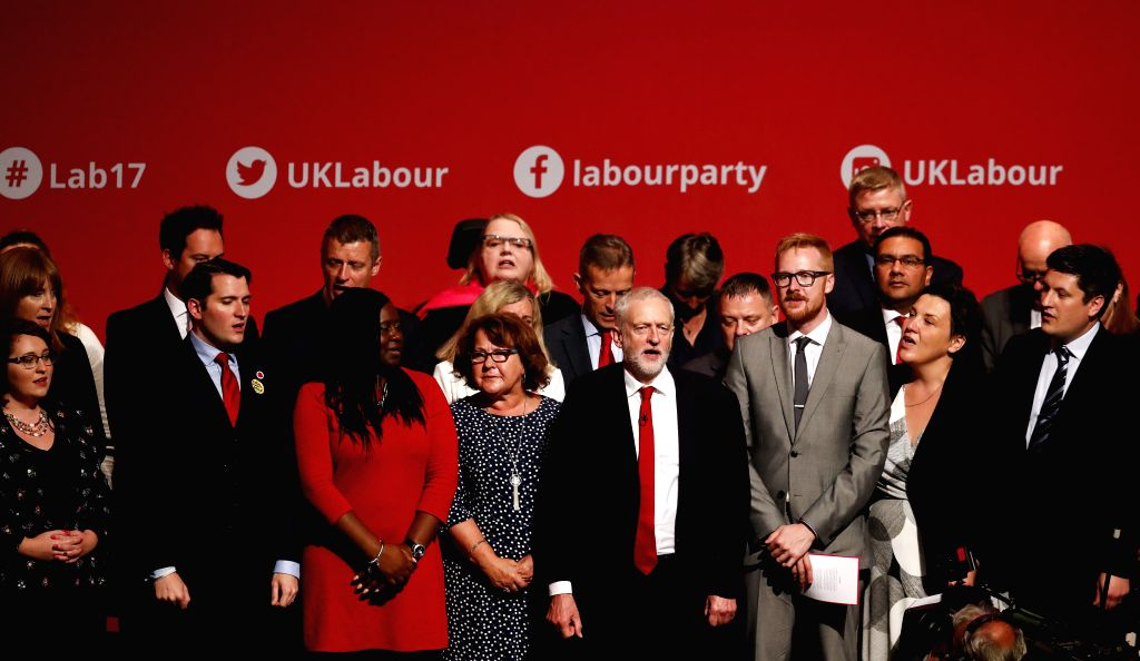 BRIGHTON, Sept. 27, 2017 - Labour Party leader Jeremy Corbyn (4th R, front) sings with attendees after his speech on the last day of the Labour Party's Annual Conference in Brighton, Britain on Sept. ...
