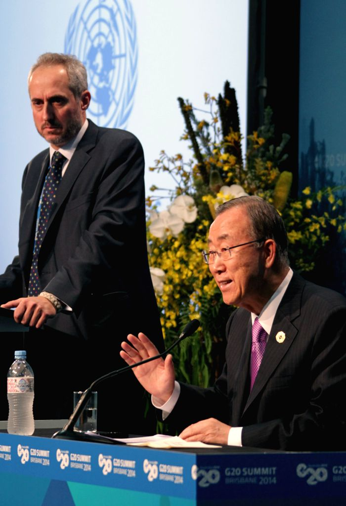 Ban Ki-moon (Front), the United Nations Secretary-General,  speaks at a press conference during the G20 Summit on Nov.15, 2014, in Brisbane, Australia.