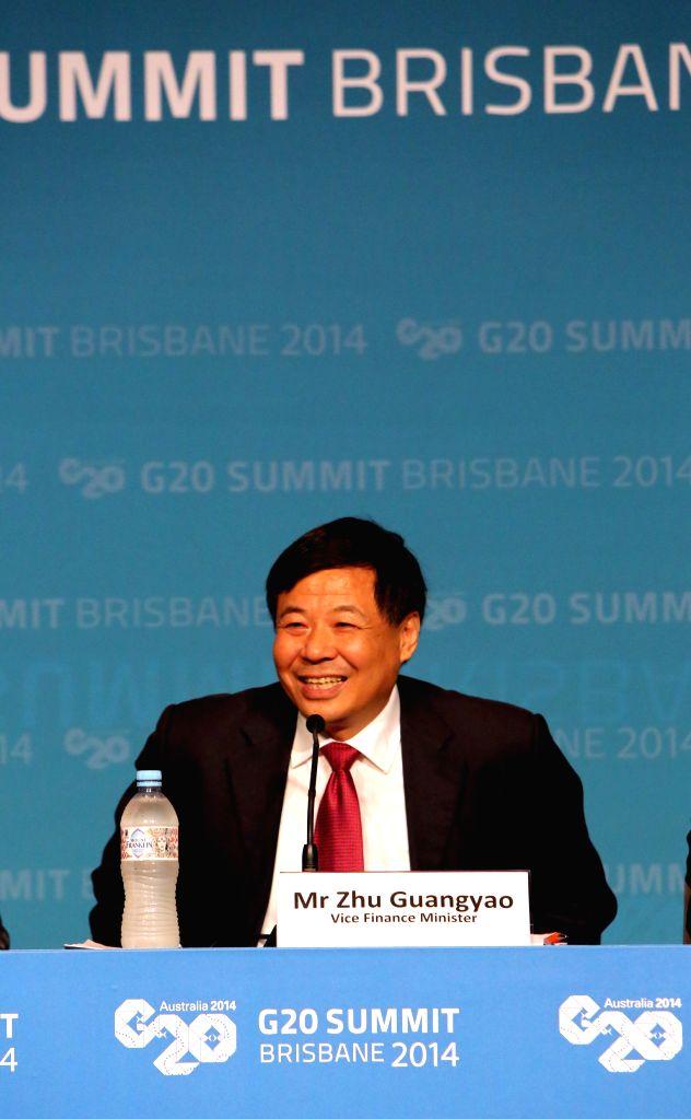 China's Vice Finance Minister Zhu Guangyao holds a press conference at the G20 summit in Brisbane, Australia, on Nov. 15, 2014. - Zhu Guangyao