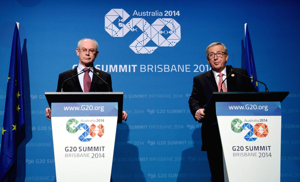 European Council President Herman Van Rompuy (L) and European Commission President Jean-Claude Juncker hold a press conference at the Brisbane Convention and Exhibition Center in Brisbane, .